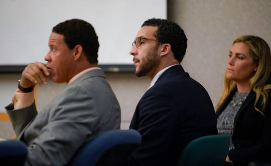 Kellen Winslow,  flanked by two of his three defense attorneys, listens to closing arguments to the jury from Deputy District Attorney Dan Owens.