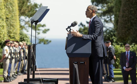 President Barack Obama speaks during the 70th French-American Commemoration D-Day Ceremony at the American cemetery in Colleville-sur-Mer, France, on June 6, 2014.