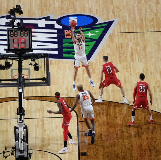 Virginia guard Ty Jerome shoots a three-point shot against Texas Tech during the NCAA tournament championship game in 2019.