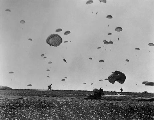Paratroopers of the Allied Army land on La Manche, on the coast of France on June 6, 1944, after Allied forces stormed the Normandy beaches during D-Day.