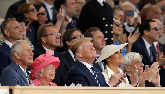 Britain's Prince Charles, from left, Queen Elizabeth II, President Donald Trump, first lady Melania Trump and Greek President Prokopis Pavlopoulos applaud as they watch a fly-past at the end of an event to mark the 75th anniversary of D-Day in Portsmouth, England, on Wednesday, June 5, 2019. World leaders including Trump, gathered Wednesday on the south coast of England to mark the 75th anniversary of the D-Day landings.