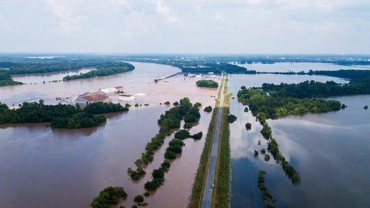 This aerial photo shows flooding along the Arkansas River in Pine Bluff, Arkansas, Tuesday, June 4, 2019.