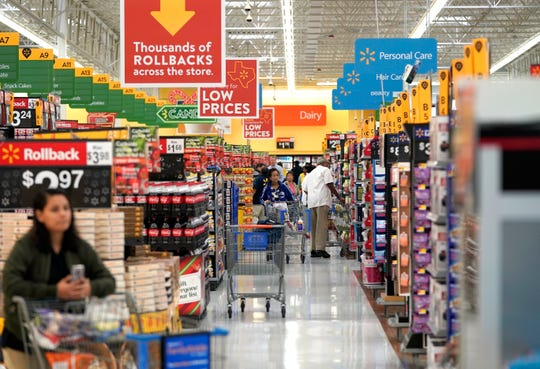 In this Nov. 9, 2018, photo shoppers walk through the isles at a Walmart Supercenter in Houston. Executives at Walmart and dollar-store chains, which import much of their merchandise and serve many low-income customers, have warned that tariffs could lead to higher prices for consumers.