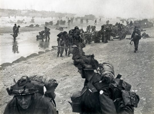 British troops land on the beaches of Normandy, France, on June 6, 1944, marking the commencement of D-Day.
