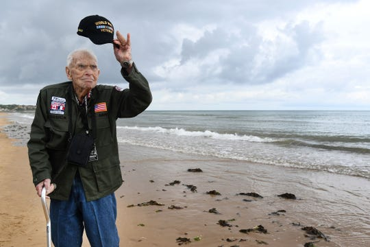 U.S. WWII veteran Loren Kissick from Puyallup, Wash., stands on Omaha Beach in Saint-Laurent-sur-Mer, France, on June 5, 2019, as part of D-Day commemorations marking the 75th anniversary of the World War II Allied landings in Normandy.