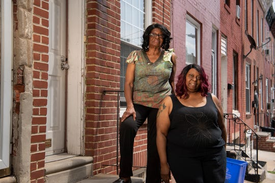 Monique Sharp, left, and Phyllis Sharp in front of their South Philadelphia home.