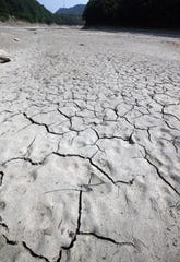 A view of the dry and cracked Obong Reservoir as a prolonged drought continues in Gangneung, Gangwon Province, South Korea. Extremes of both wet and dry are predicted to increase due to climate change.