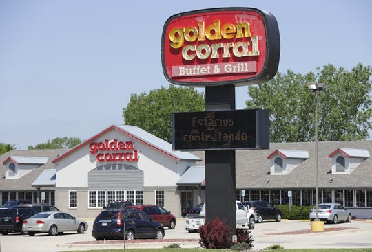 """Estamos contratando"" on Golden Corral's electronic sign means ""we're hiring."""