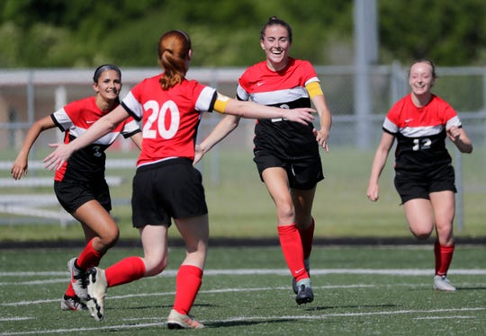 Kimberly High School's Courtney Rammer (20) runs into the arms of Elsi Twombly (23) as they celebrate a 2-1 victory against Appleton East High School during their WIAA Division 1 sectional semifinal girls soccer game at Papermaker Stadium Thursday, June 6, 2019, in Kimberly, Wis. Twombly scored both goals for Kimberly.Dan Powers/USA TODAY NETWORK-Wisconsin
