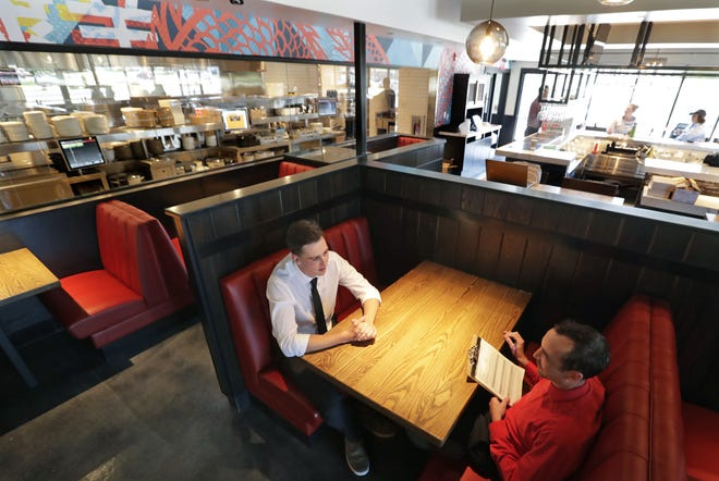 Timothy Collins, left, of Hortonville interviews for a job at P.F. Chang's with senior manager Jerrod Mills.