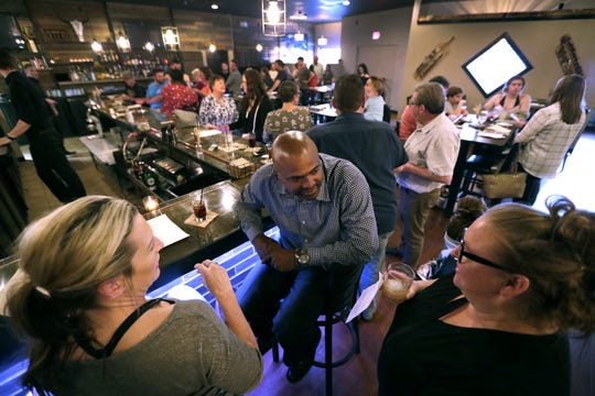 "Jacqueline Wynn, left, Larry Wynn and Abby Williams, right, enjoy cocktails during a ""friends and family"" test night Tuesday at Savor Food and Spirits in Kimberly."