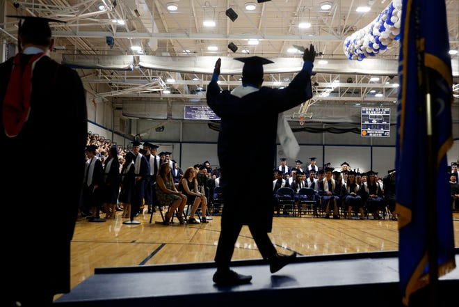 A student celebrates his graduation during the Menasha High School graduation ceremony at Menasha High School on June 5, 2019. This year, high schools across the Fox Valley and the state have had to find alternative ways to celebrate graduating seniors because of coronavirus.