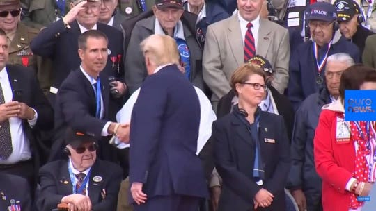 Mike Malone gets a handshake from President Trump during Thursday's D-Day commemoration.