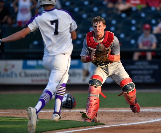 Albany catcher Parker Henry grits his teeth as Big Sandy's Hunter Williams runs down the third base line toward him Wednesday in Round Rock June 5, 2019. Big Sandy won the Class 2A semifinal game, 4-1.