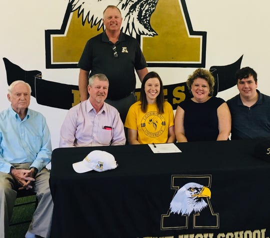 Abilene High golfer Lyra Rains, middle, committed to LeTourneau at a ceremony with family and coach Wayne Williams, standing, on Thursday morning. Rains placed eighth in the District 3-6A tournament and was a first team Academic All-State selection.