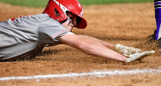 Albany's Cade Neve slides into third base against Big Sandy during Wednesday's Class 2A semifinal game in Round Rock June 5, 2019. Neve minutes later scored the Lions only run in the game. Big Sandy won, 4-1.