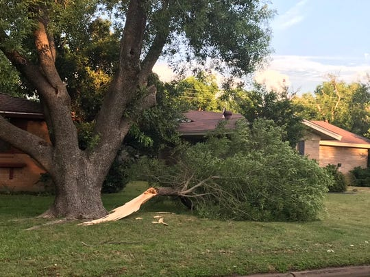 Yards and driveways in south Abilene were littered with broken tree branches, with some entire trees and power line toppled by winds from Wednesday afternoon's thunderstorm in Abilene.