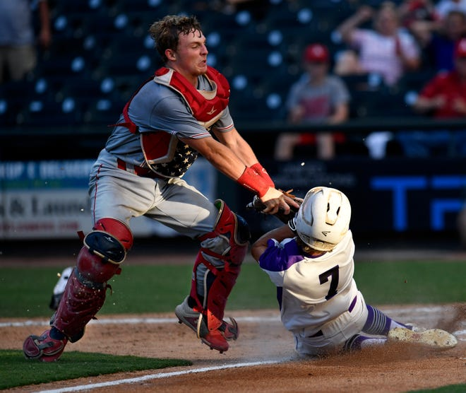 Albany catcher Parker Henry tags out Big Sandy's Hunter Williams during Wednesday's semifinal Class 2A baseball game at Round Rock. Big Sandy won, 4-1.