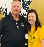 Abilene High golfer Lyra Rains, right, poses with head coach Wayne Williams after committing to LeTourneau at Thursday morning's ceremony.