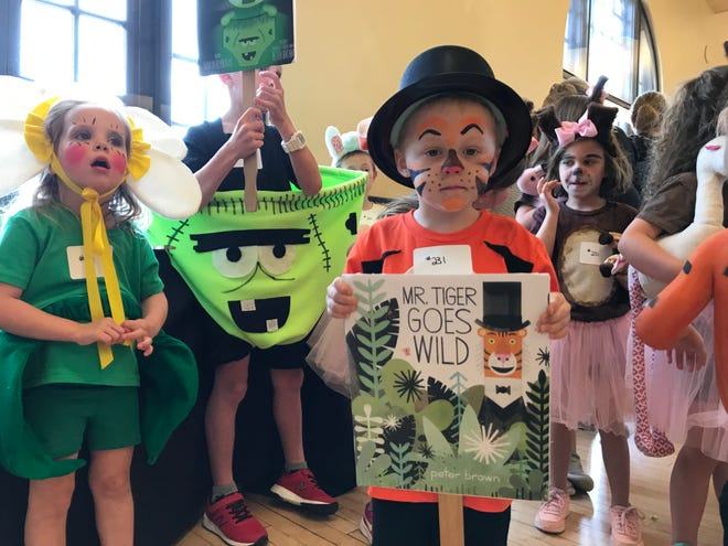 James Parker, 4 , is dressed as Mr. Tiger for the eighth Children's Art & Literacy Festival costume contest. The 2020 event has been delayed until June 2021.