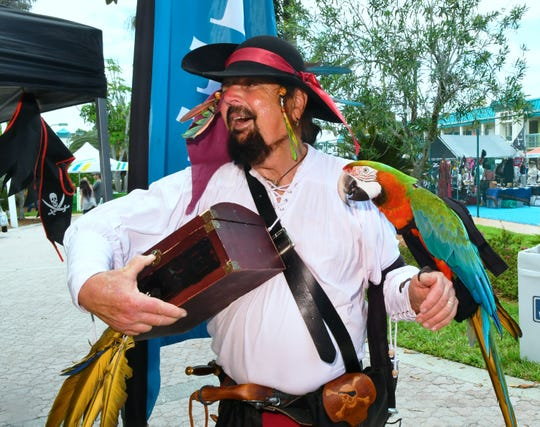 David Colston, AKA, Capt. Red Legs Greaves, with M.A.R.S. Parrott Rescue at a previous Cocoa Beach Pirate Fest.