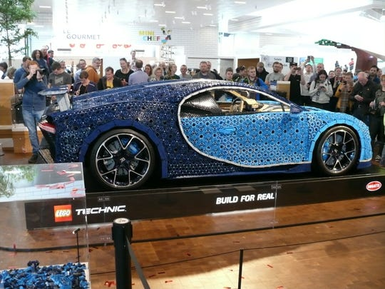 A crowd gathers at the Lego House in Billund, Denmark, as full-sized Bugatti Chiron made of toy bricks is unveiled.