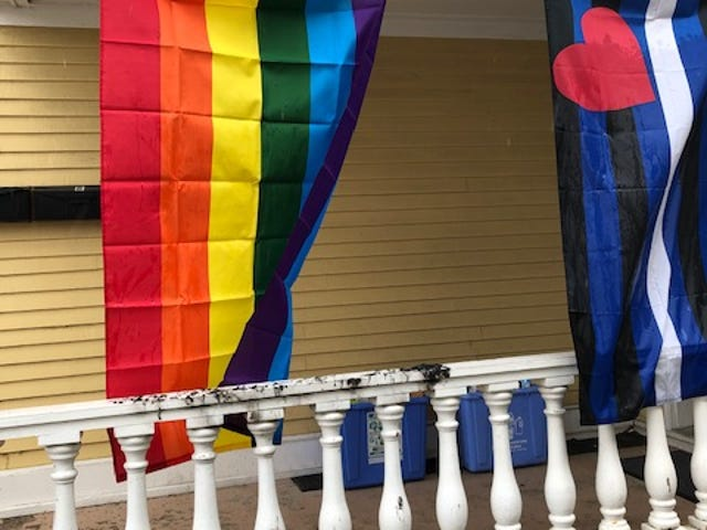 A brand new Pride Flag hangs at the home of Christopher Vaccaro and Jimmie Searle, victims of a recent hate crime in the North end of Burlington.