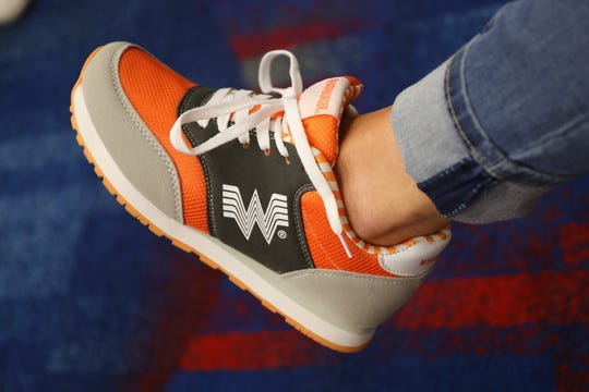 Whataburger custom running shoes are available for $42.99 on Whataburger's website.