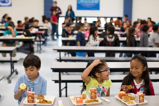 Students eat lunch in the cafeteria Thursday, Oct. 26, 2017, at Travis Elementary in Corpus Christi.