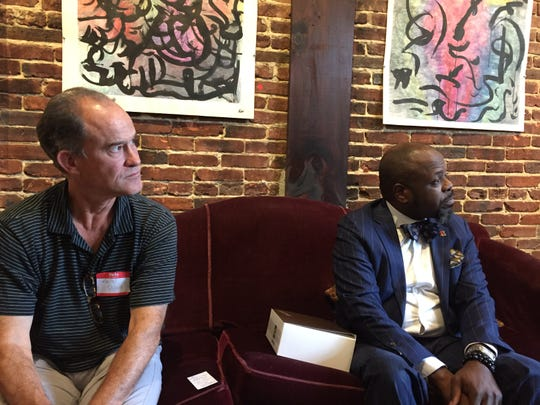 Kevin Quinn, left, of the New Jersey Economic Development Authority and Derrick Green, a senior advisor to Gov. Phil Murphy, listen as Camden residents talk about their city.