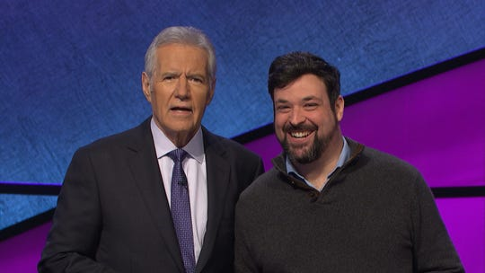 Jonathan Greenstein of Mount Laurel tapes an episode of 'Jeopardy!' in March with Alex Trebek said he tried qualifying for 'Jeopardy!' over the course of 11 years before scoring high enough to get on the show.