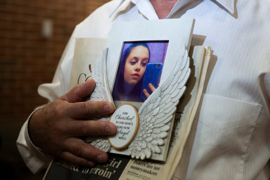 Steve McDonald holds a photo of his daughter Madison McDonald following a sentencing for Austin Cooper at Burlington County Superior Court in Mount Holly, N.J. Thursday, June 6, 2019. Cooper pleaded guilty in April to one count of strict liability for drug-induced death in exchange for eight years in state prison.