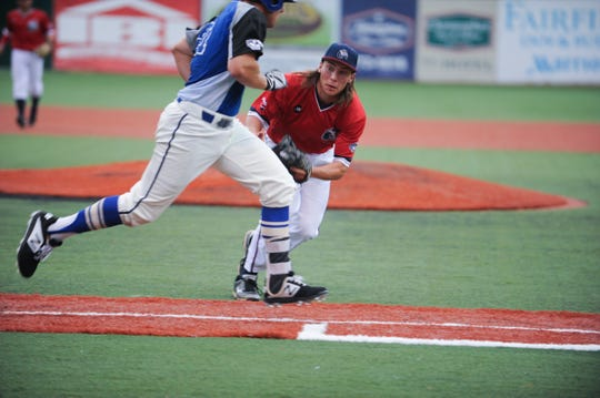Chillicothe Paints pitcher Nick Smith attempts to tag a Terre Haute Rex batter running to first base in the Paints' 5-3 loss to the Rex on Wednesday at VA Memorial Stadium.