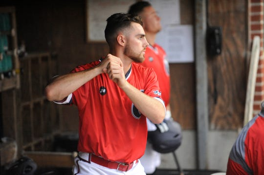 Cody Orr works on his timing in dugout in a 5-3 loss to Terre Haute on June 5. Orr has dominated on the mound and at the plate for the Paints so far this season.