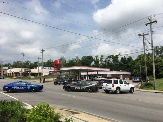 Police shut down Dixie Highway in front of an Erlanger gas station where an officer was reportedly shot at during a traffic stop June 6, 2019, by a man who fled the scene on foot.