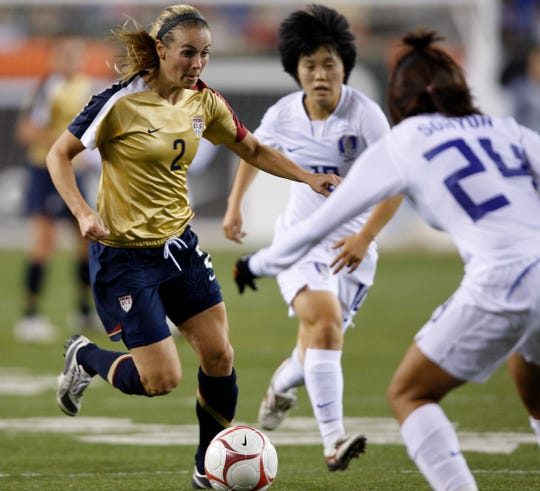 The United States' Heather Mitts takes on  South Korea's Cho So Hyun in the first half at Paul Brown Stadium Wednesday November 4, 2008.