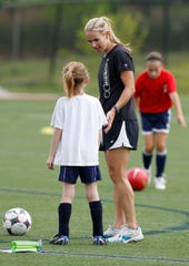 Brandon Severn/Contributor. Heather Mitts breaks down the drills with a camper.