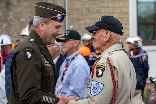 Maj. Gen. Brian Winski, 101st Airborne Division commander, exchanges word with World War II Veteran Tom Rice during the Cabbage Patch Ceremony and Parade at Carentan, France June 5, 2019.
