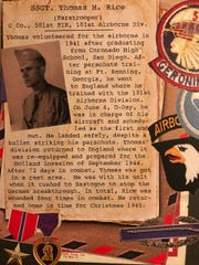 Documents and mementos of veteran Tom Rice's service in WWII with the 101st Airborne Division.