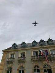 Flags and aircraft flying over the Chateau de Bernaville in Normandy for the 75th anniversary of D-Day.