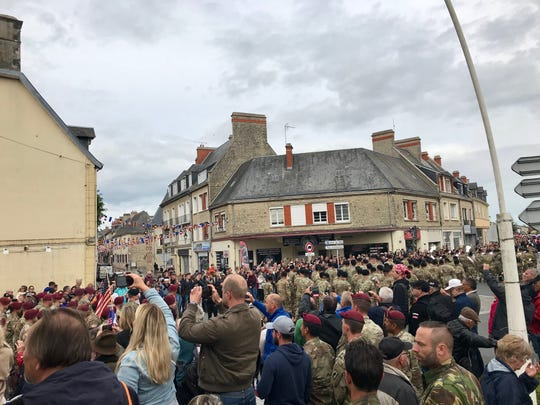 Crowds of people fill the streets of Carentan, France, as the world marks the 75th anniversary of the D-Day invasion of Normandy.