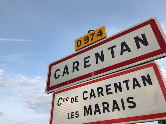 Signs for Carentan, the town in Normandy that was liberated by the 101st Airborne in the days following the D-Day invasion 75 years ago.