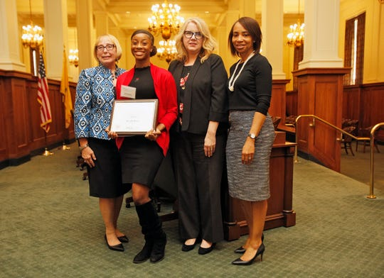 (Left to right) Assistant Director of the Office of Child Support Services Patricia Risch, Darielle Moore, New Jersey Department of Human Services Commissioner Carole Johnson and Natasha Johnson, director of the New Jersey Department of Human Service's Division of Family Development.