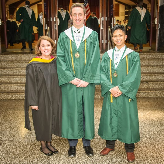 During Saint Joseph High School's 2019 graduation commencement exercises, Principal Anne Rivera (left) posed with salutatorian Michael Botting (center) and valedictorian Matthew Vergel (right) at the Church of the Sacred Heart in South Plainfield.