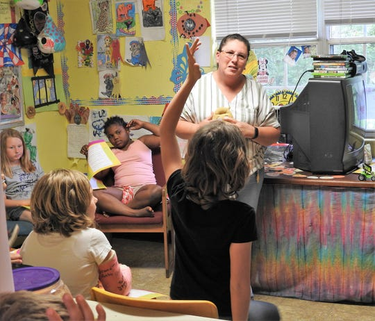 A child raises her hand to answer a question from Collette Burdette at Chestnut Crossing Learning Center. She's the SNAP-Ed Program Assistant for the local OSU Extension Office, providing programming on different foods and nutrition lessons to youth. The Extension Office of Coshocton County is seeking a renewal of a levy on the fall general election ballot to help with services and programs.