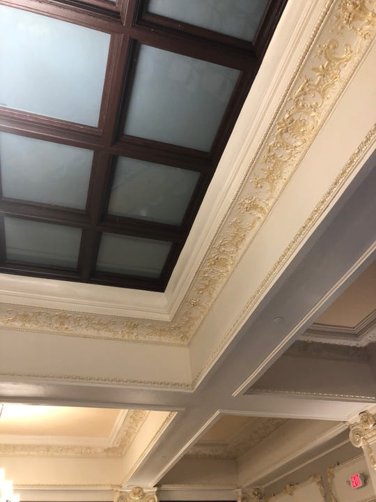 Jack Hatch says the finished work of the craftsmen is indistinguishable from the original molding in the completed restoration of the ballroom.