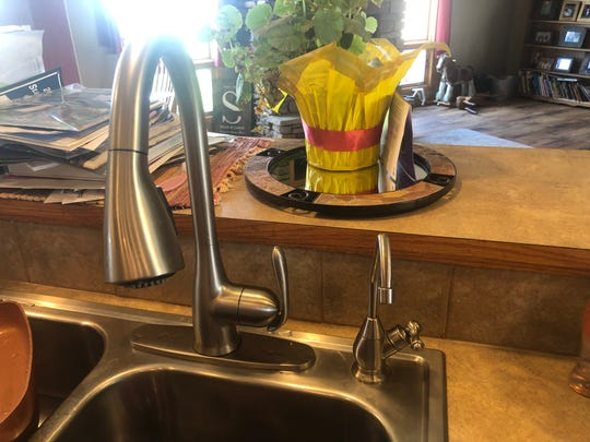 The Bradley and Jamie Stephens home south of Pacific Junction, Iowa, uses a reverse osmosis system to process well water for safe drinking. Water from that system is routed through the smaller spigot on the kitchen sink.