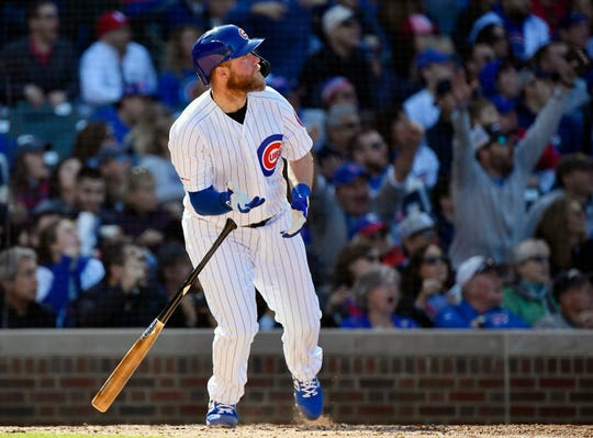 Chicago Cubs catcher Taylor Davis hits a grand slam ball against the St. Louis Cardinals on May 4.