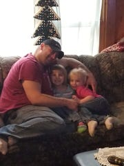 "Robert Joseph Quick shown in an undated family photo with two of his children. The man affectionately known as ""Joe"" died trying to save his 4- and 5-year-old daughters from an attacking dog May 31, 2019, in Fort Madison."