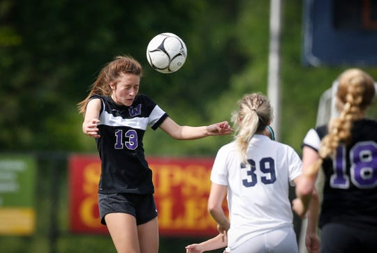 Waukee sophomore Haley Horman heads the ball against Pleasant Valley in Class 3A during the semifinals of the 2019 Iowa high school girls state soccer tournament at Cownie Soccer Complex in Des Moines on Thursday, June 6, 2019.